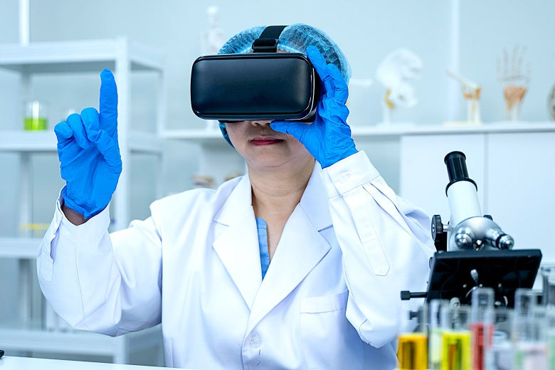 A doctor in a lab coat wearing a VR headset