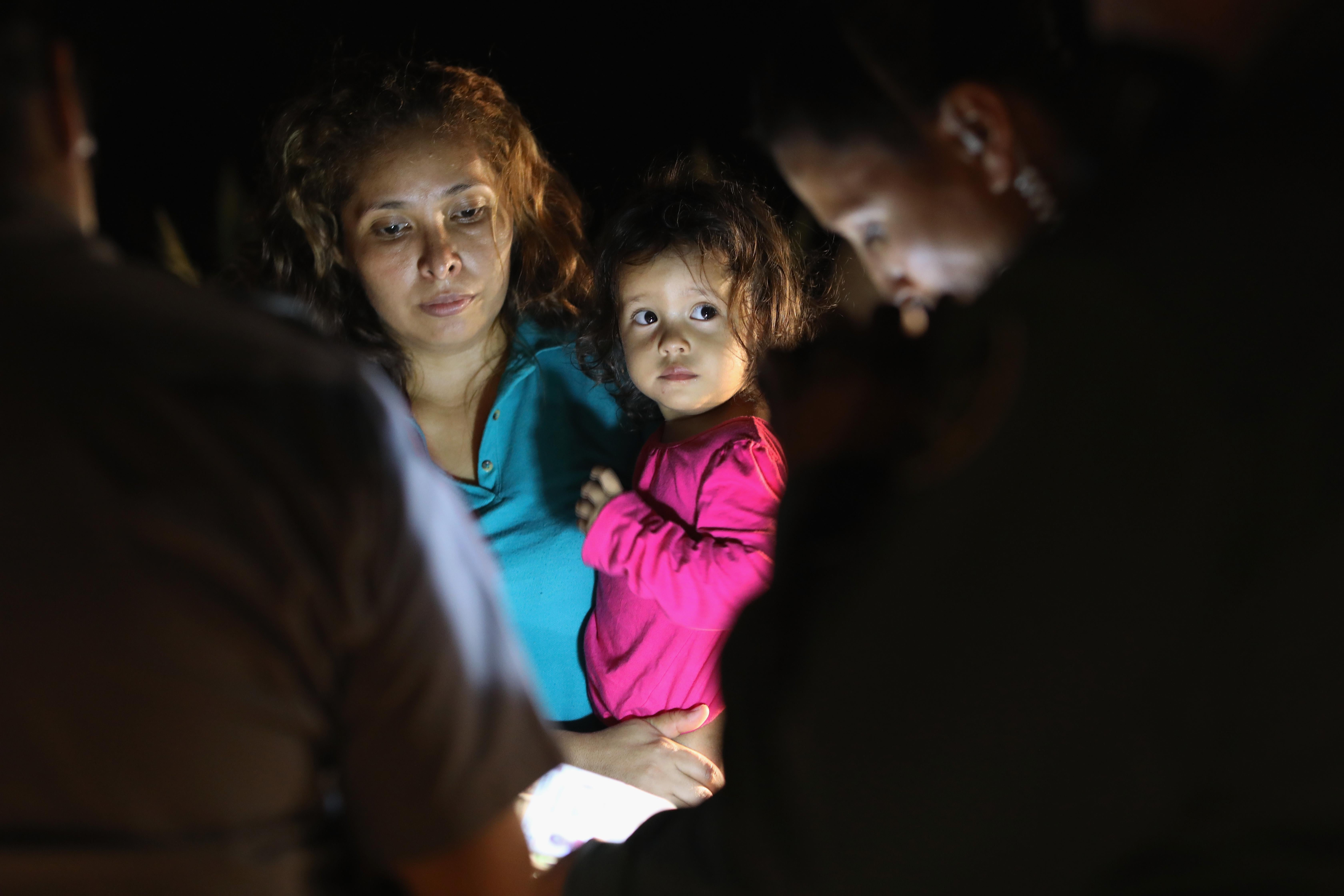 Central American asylum seekers, including a Honduran girl, 2, and her mother, are taken into custody near the U.S.-Mexico border on June 12, 2018 in McAllen, Texas.