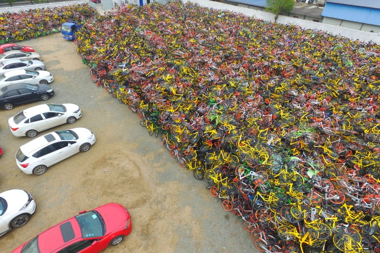 Tens of thousands of abandoned shared bikes pile up at a parking lot in the Jiangning District of Nanjing, China, on Nov. 28.