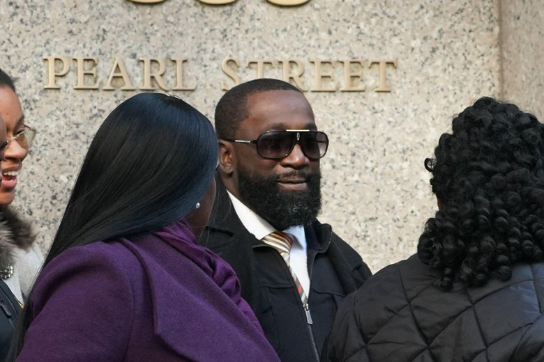Metropolitan Correctional Center guard Michael Thomas (C) surrounded by supporters leaves Federal Court in New York City on November 25, 2019.