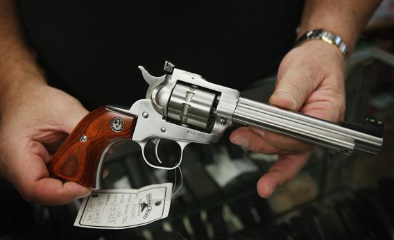 Fred Lutger, owner of Freddie Bear Sports, shows a Ruger Single Ten .22 caliber revolver.