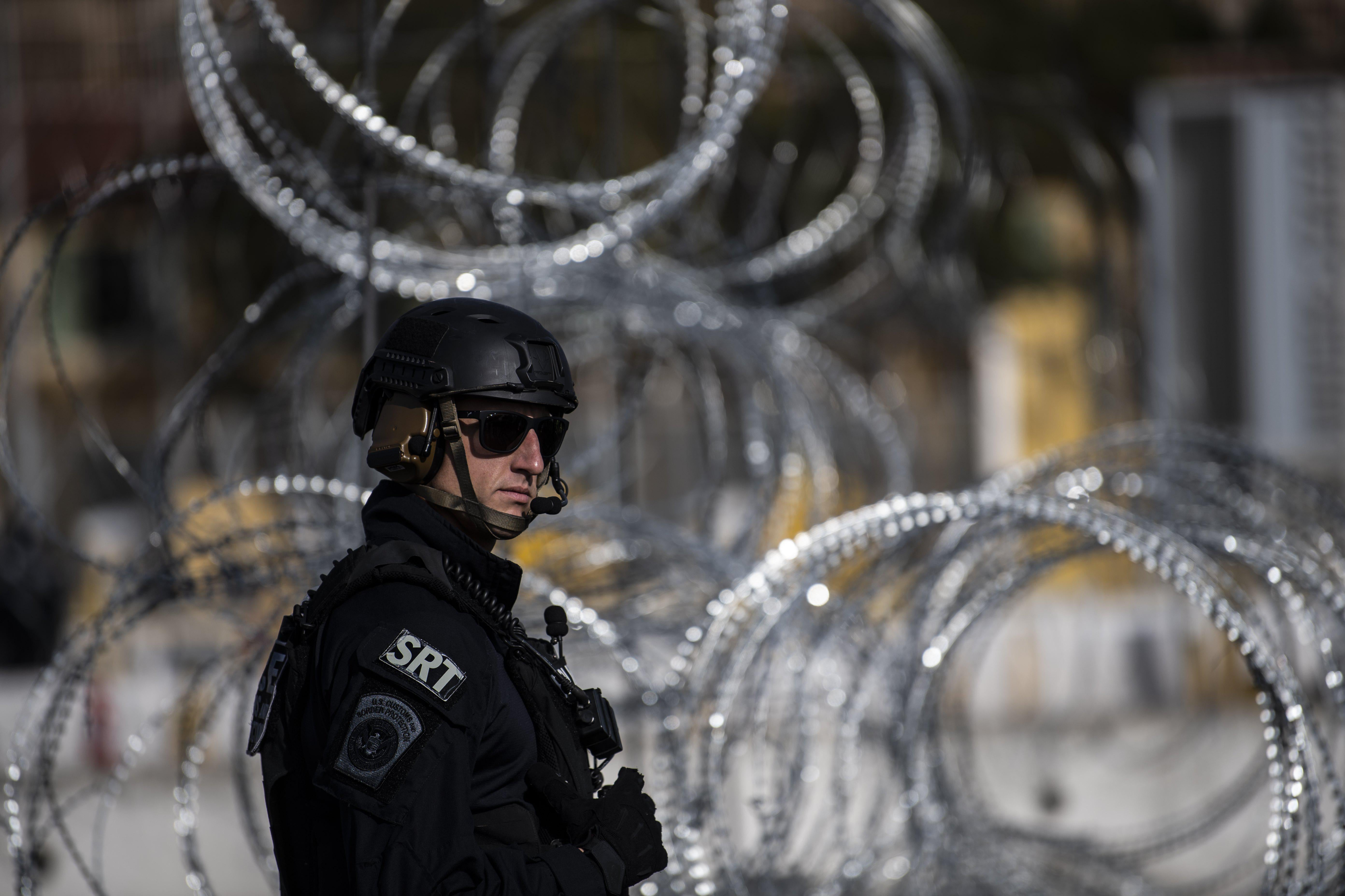 A US Customs and Border Protection (CBP) officer takes part in a operational readiness exercise at the San Ysidro port of entry in the United States as seen from Tijuana, Baja California State, Mexico, on November 22, 2018.
