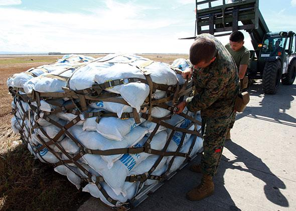 US marines prepare relief for people affected in the aftermath of Typhoon Haiyan.