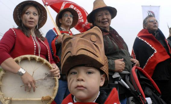 Young Isaiah with his Haida clan members at a welcome opening at the Haida Heritage Center.