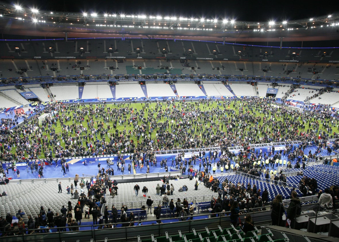 Spectators waited on the field of France's national stadium, the Stade de France