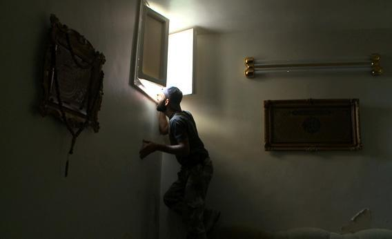 A Free Syrian Army sniper in Saif al-Dawla