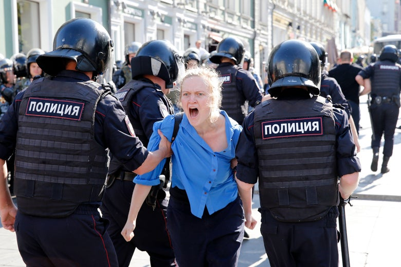 Police officers detain a protester during a rally demanding independent and opposition candidates be allowed to run for office in local election in September, in downtown Moscow on July 27, 2019.