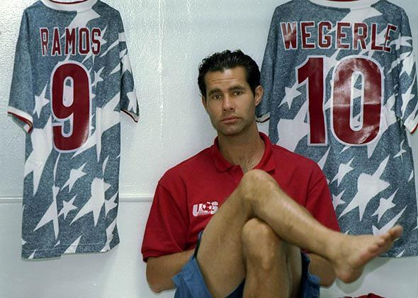 The U.S. national team's Roy Wegerle looks thrilled to pose in front of his jersey.