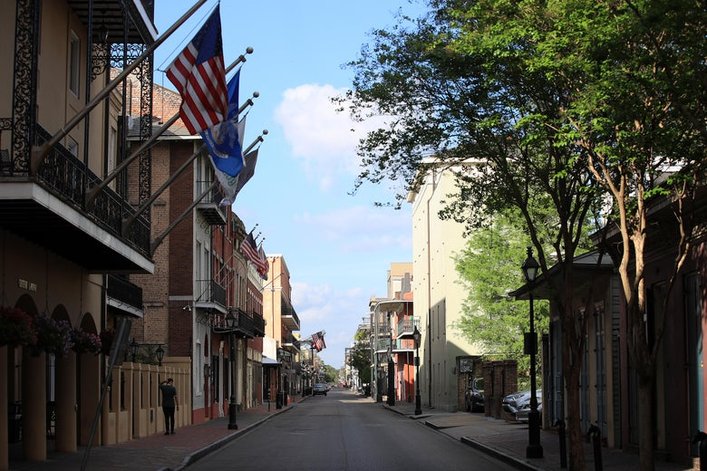 A view of an empty street in New Orleans on a sunny day.