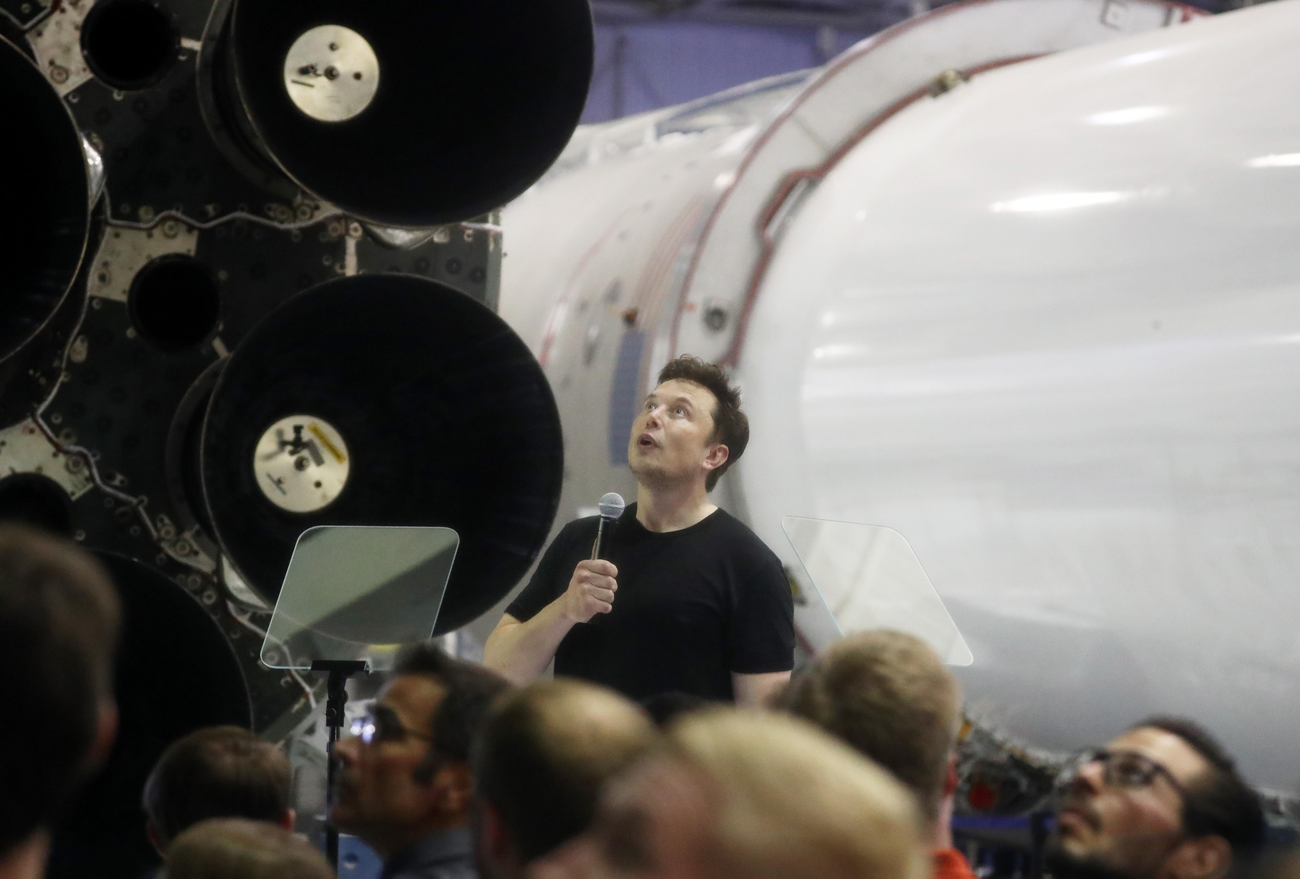 Elon Musk speaking at the headquarters of SpaceX, his rocket company