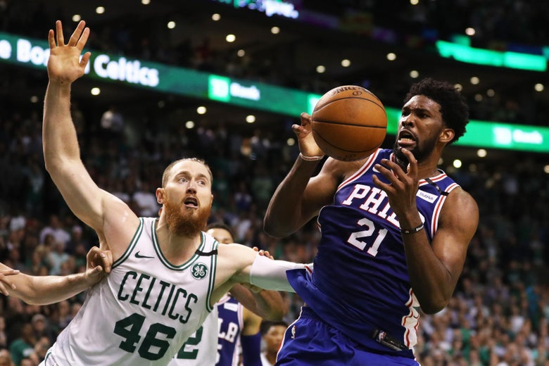 BOSTON, MA - MAY 9: Aron Baynes #46 of the Boston Celtics and Joel Embiid #21 of the Philadelphia 76ers battle for a rebound during Game Five of the Eastern Conference Second Round of the 2018 NBA Playoffs at TD Garden on May 9, 2018 in Boston, Massachusetts. The Celtics defeat the 76ers 114-112 to advance to the Eastern Conference Finals. (Photo by Maddie Meyer/Getty Images)