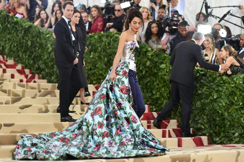 Lawyer Amal Clooney arrives for the 2018 Met Gala on May 7, 2018, at the Metropolitan Museum of Art in New York. - The Gala raises money for the Metropolitan Museum of Arts Costume Institute. The Gala's 2018 theme is Heavenly Bodies: Fashion and the Catholic Imagination. (Photo by Angela WEISS / AFP)        (Photo credit should read ANGELA WEISS/AFP/Getty Images)