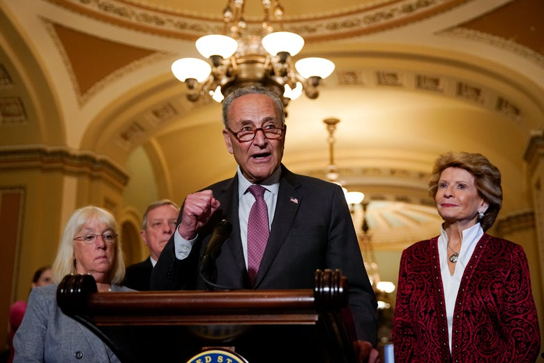Schumer is flanked by Murray, Durbin, and Stabenow as he talks to reporters at the U.S. Capitol.