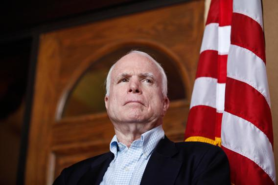 U.S. Senator John McCain (R-AZ) watches his colleagues speak during a news conference following their tour of the Arizona-Mexico border in Nogales, Arizona March 27, 2013.