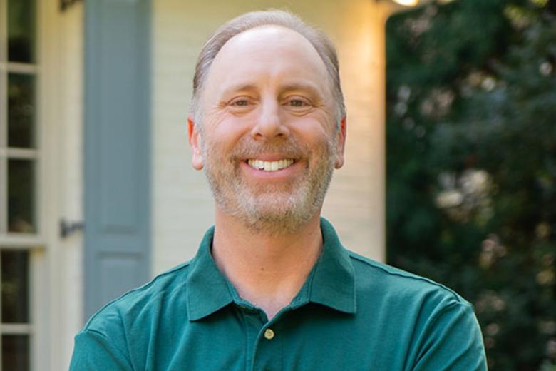 Matt Lieberman smiling in front of his house.