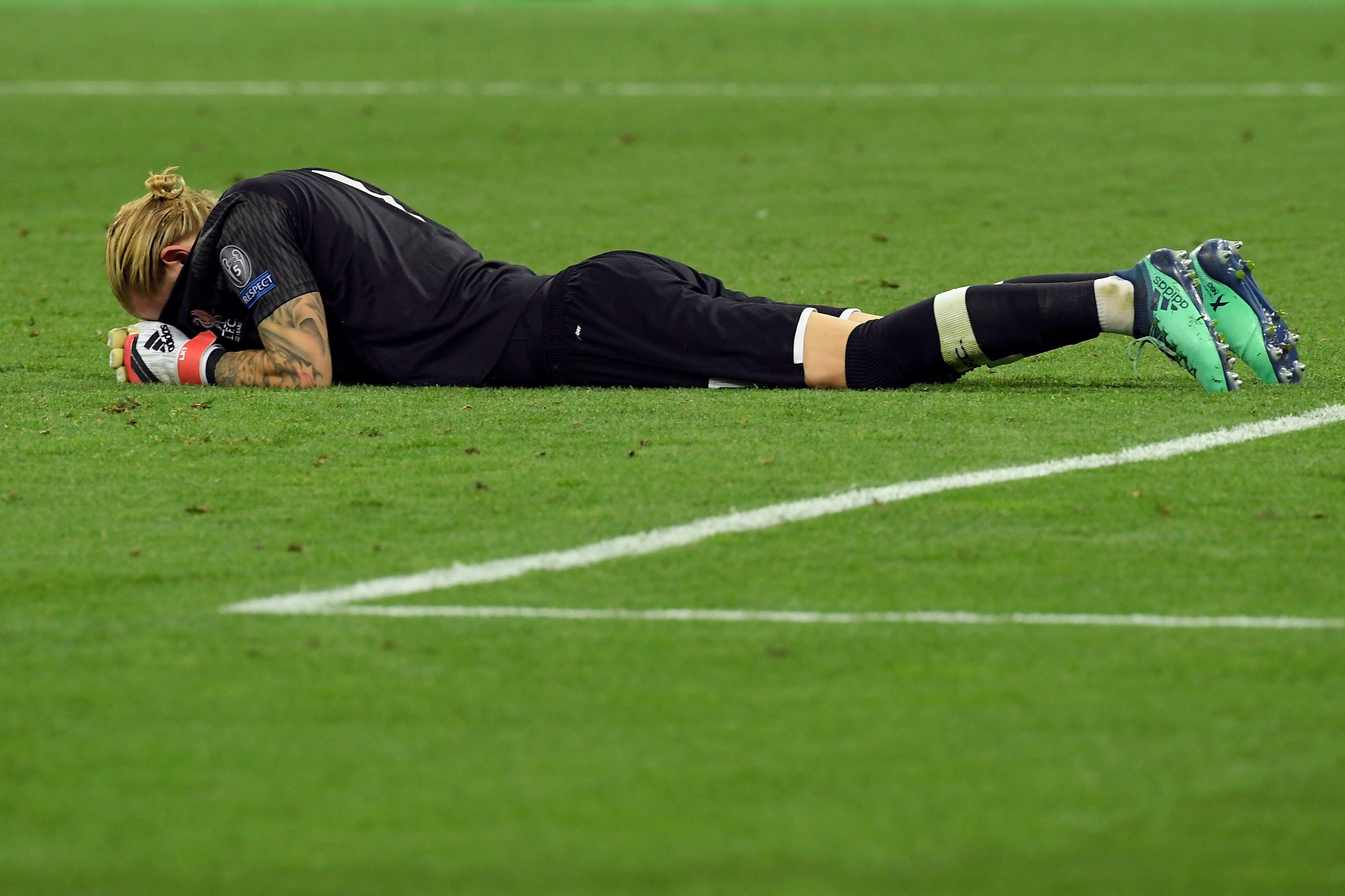 Liverpool's German goalkeeper Loris Karius reacts after the UEFA Champions League final football match between Liverpool and Real Madrid at the Olympic Stadium in Kiev, Ukraine on May 26, 2018. - Real Madrid defeated Liverpool 3-1. (Photo by LLUIS GENE / AFP)        (Photo credit should read LLUIS GENE/AFP/Getty Images)