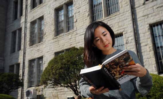 A student reads a book at Korea University in Seoul.