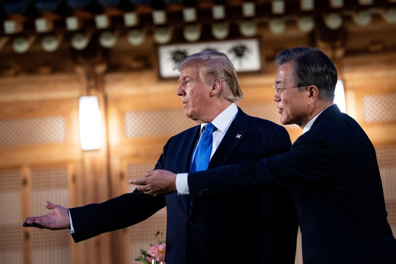 President Donald Trump and South Korea's President Moon Jae-in stand together before a working dinner at the tea house on the grounds of the presidential Blue House in Seoul on June 29, 2019.