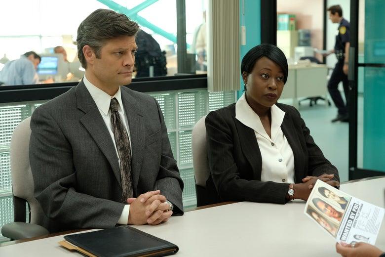 Jay R. Ferguson as FBI Agent Evans and Christine Horn as FBI Agent Gruber.