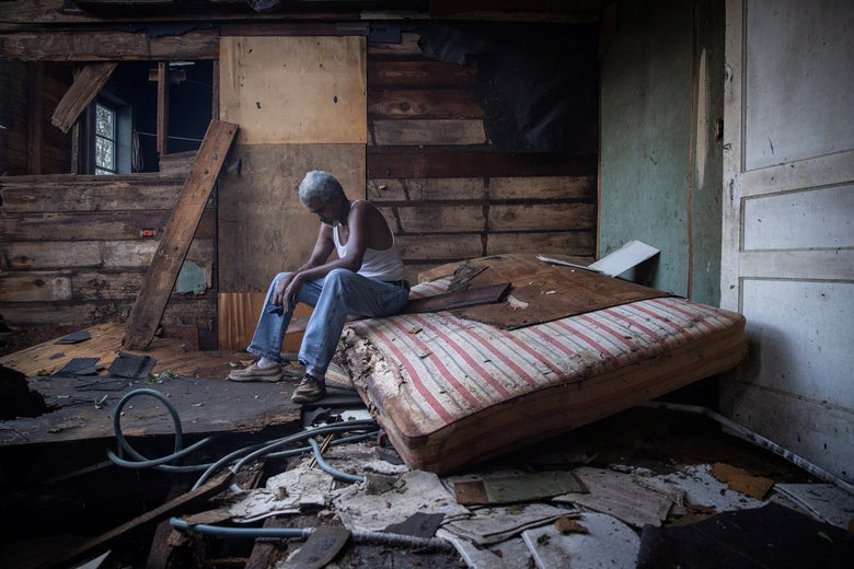 Theophilus Charles, 70, sits inside his house which was heavily damaged by Hurricane Ida in Houma, Louisiana, August 30, 2021.
