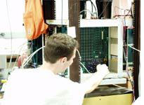 Dave examines signals on a problem-child circuit board