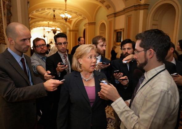 Sen. Mary Landrieu (D-LA) talks with reporters before attending a Senate Democratic caucus meeting at the U.S. Capitol September 30, 2013 in Washington, DC.