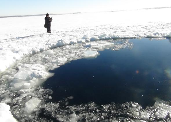 A hole in the Chebarkul Lake made by meteor fragments. A meteor shower hit Russia's Chelyabinsk region on February 15, 2013.
