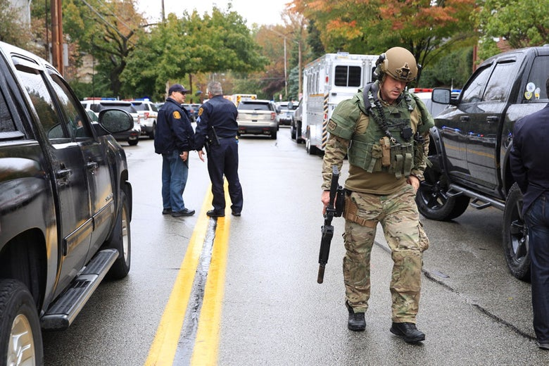 A SWAT police officer and other first responders respond after a gunman opened fire at the Tree of Life synagogue in Pittsburgh, Pennsylvania on October 27, 2018.