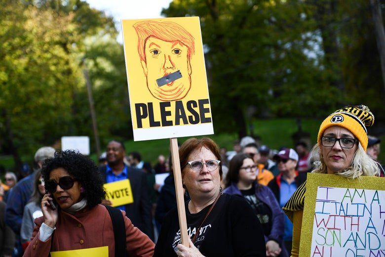 People protesting against US President Donald Trump wait near the Tree of Life Congregation on October 30, 2018 in Pittsburgh, Pennsylvania. - The first two victims of the deadliest anti-Semitic attack in recent US history were laid to rest in Pittsburgh on Tuesday as the grieving city awaits a controversial visit by President Donald Trump and his wife Melania.Trump's visit to the city has been contentious, coming amid a mounting row over whether his fierce rhetoric at campaign rallies and on Twitter has helped stoke extremism ahead of November 6 midterm elections. A protest in Pittsburgh against the president has been called for Tuesday afternoon. (Photo by Brendan Smialowski / AFP)        (Photo credit should read BRENDAN SMIALOWSKI/AFP/Getty Images)
