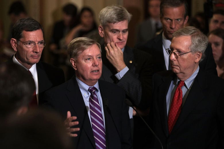 WASHINGTON, DC - SEPTEMBER 19:  U.S. Sen. Lindsey Graham (R-SC) (2nd L) speaks as (L-R) Sen. John Barrasso (R-WY), Sen. Bill Cassidy (R-LA), Sen. John Thune (R-SD), and Senate Majority Leader Sen. Mitch McConnell (R-KY) listen during a news briefing after the weekly Senate Republican policy luncheon at the Capitol September 19, 2017 in Washington, DC. Senate Republican held a weekly policy luncheon to discuss GOP agenda.  (Photo by Alex Wong/Getty Images)