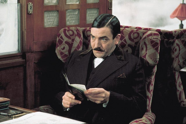 Albert Finney with a large moustache.