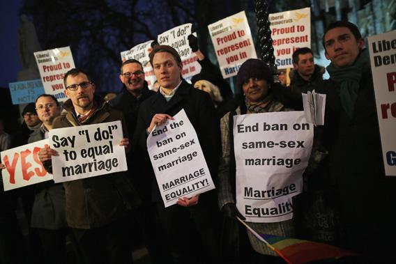 Gay rights campaigners gathering outside the Houses of Parliament on Feb. 5, 2013, in London, where Parliament held a vote on whether to allow same-sex couples to marry