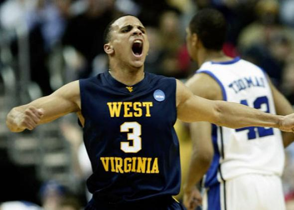 Joe Mazzulla #3 of the West Virginia Mountaineers celebrates scoring against the Duke Blue Devils.