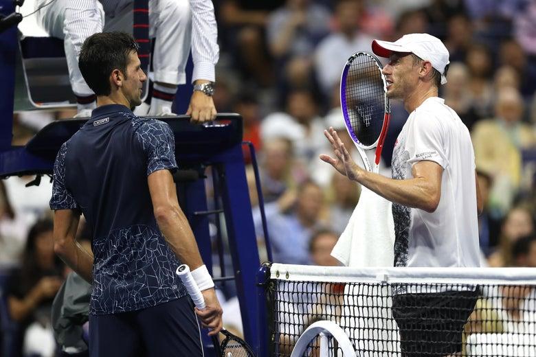 Novak Djokovic of Serbia and John Millman of Australia argue.