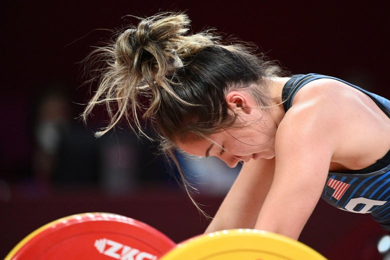Jourdan Elizabeth Delacruz reacts as she competes in the women's 49kg weightlifting competition during the Tokyo 2020 Olympic Games at the Tokyo International Forum in Tokyo on July 24, 2021.