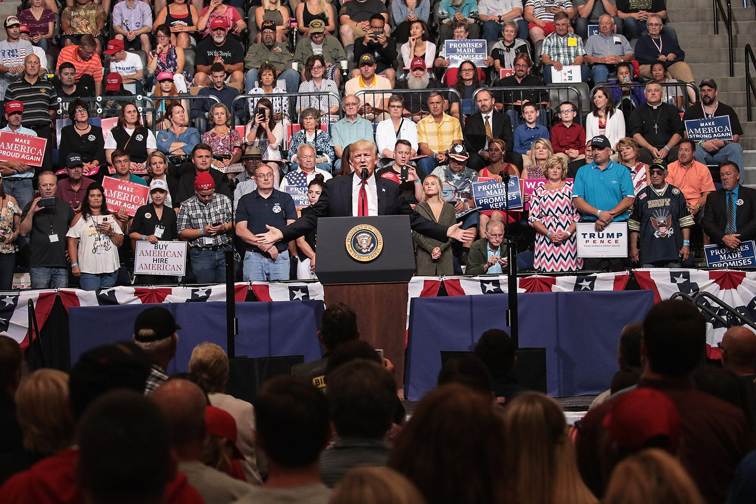 President Donald Trump speaks at a rally on June 21 in Cedar Rapids, Iowa. Trump spoke about renegotiating NAFTA and building a border wall that would produce solar power during the rally.