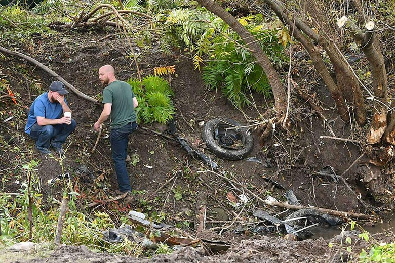 Distraught family members take in the scene October 7, 2018 in Schoharie, New York, one day after an accident that left 20 people dead.