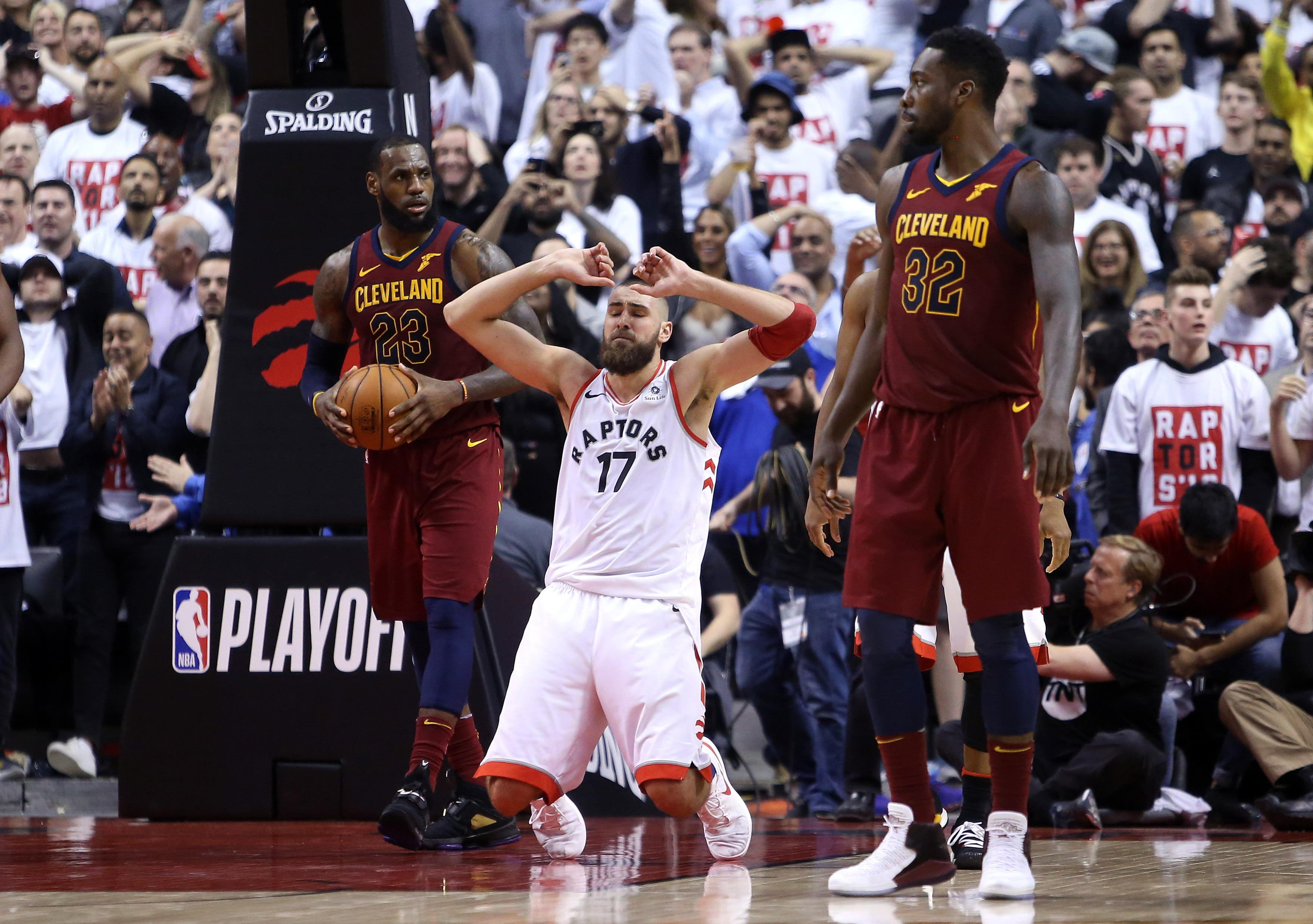 TORONTO, ON - MAY 01:  Jonas Valanciunas #17 of the Toronto Raptors falls to his knees after missing a basket in the second half of Game One of the Eastern Conference Semifinals against the Cleveland Cavaliers during the 2018 NBA Playoffs at Air Canada Centre on May 1, 2018 in Toronto, Canada.  NOTE TO USER: User expressly acknowledges and agrees that, by downloading and or using this photograph, User is consenting to the terms and conditions of the Getty Images License Agreement.  (Photo by Vaughn Ridley/Getty Images)