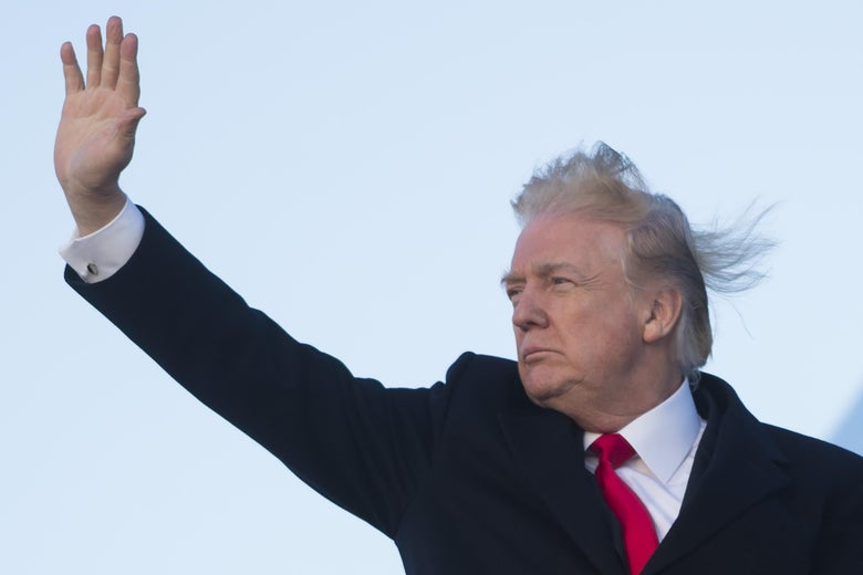 President Donald Trump waves from Air Force One prior to departure from Joint Base Andrews in Maryland, February 2, 2018, as he travels to Mar a Lago in West Palm Beach, Florida, for the weekend.