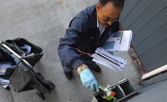 A US Postal Service letter carrier.