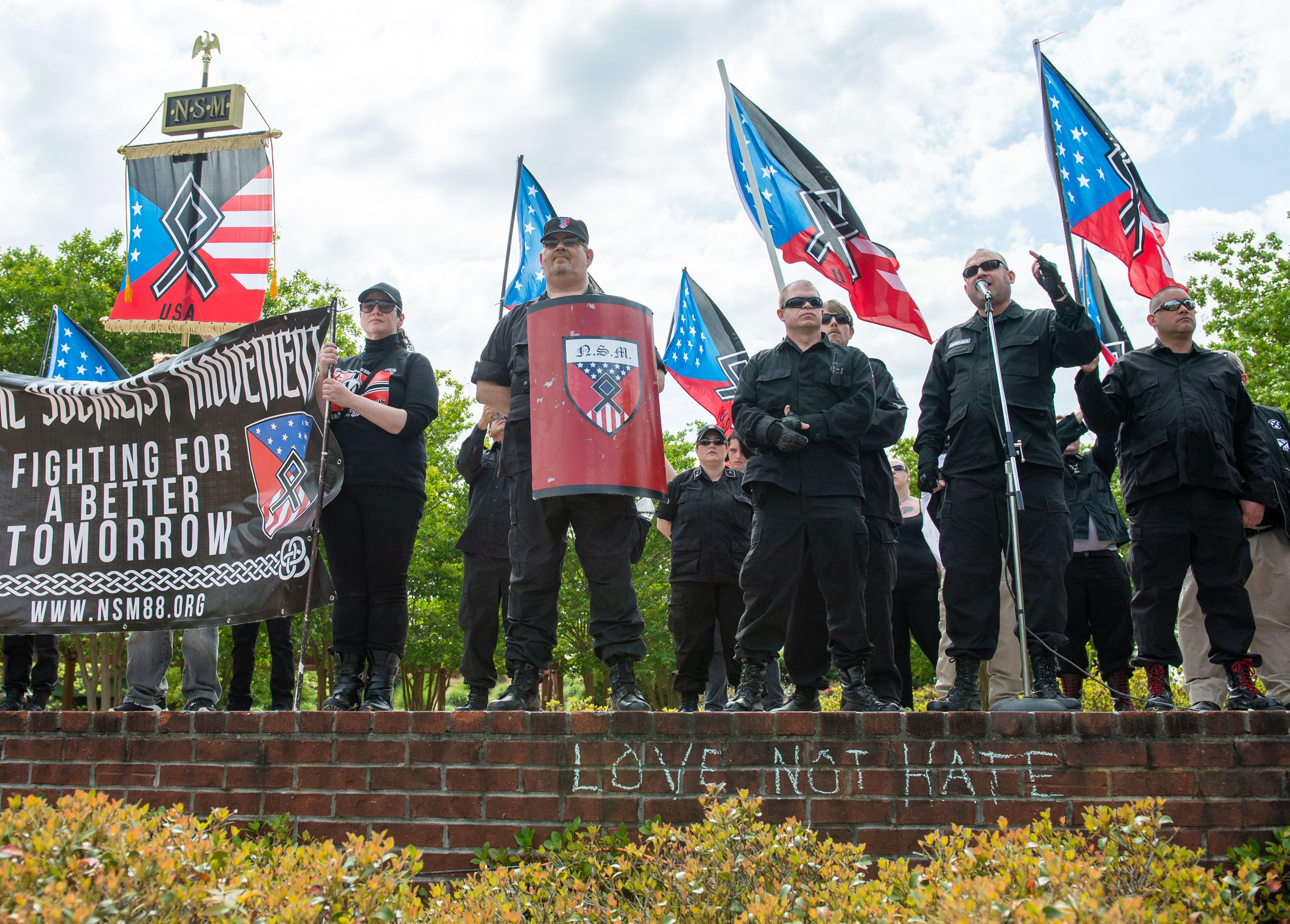 National Socialist Movement leader Jeff Schoep (2nd R) speaks during a white nationalist rally in Newnan, Georgia on April 21, 2018.