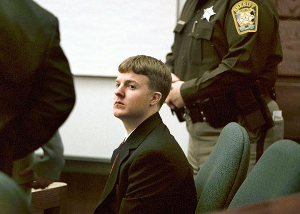 Justin Michael Wolfe, 20, on trial for capital murder of Daniel Robert Petrole, Jr. is seen in the Prince William County courthouse in Manassas, Va., Wednesday Jan. 9, 2002.