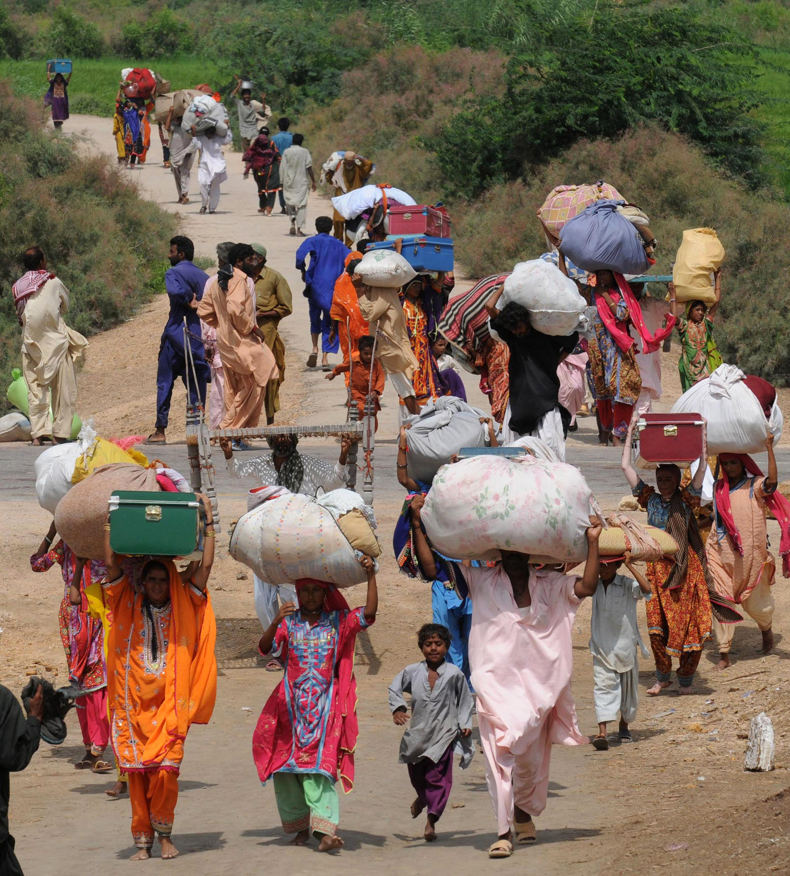 Women carrying parcels on their heads.