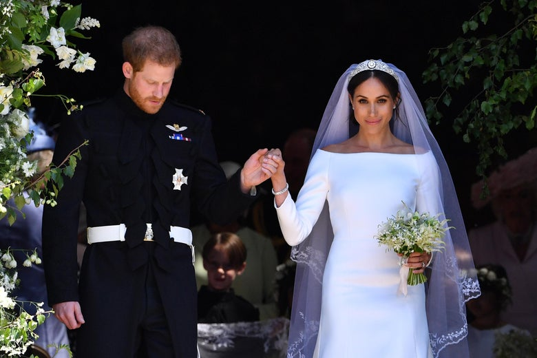 Prince Harry holds Meghan's hand as they emerge from the West Door of St George's Chapel, Windsor Castle, after their wedding ceremony.