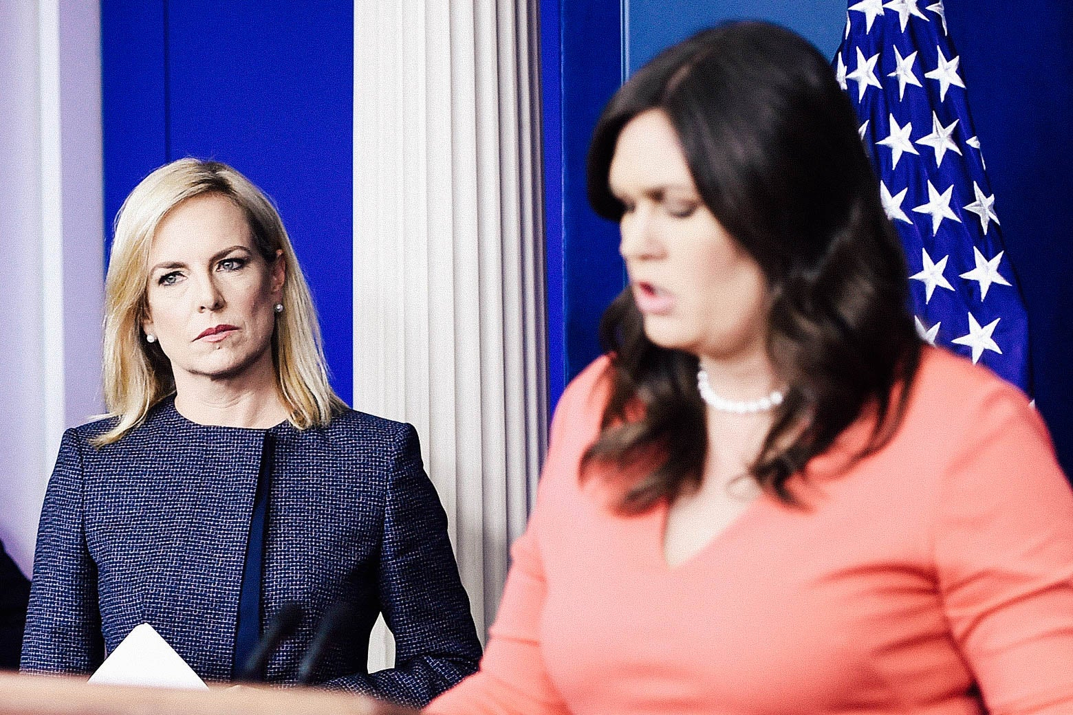 Secretary of Homeland Security Kirstjen Nielsen looks on as White House spokesperson Sarah Huckabee Sanders speaks during a press briefing at the White House.