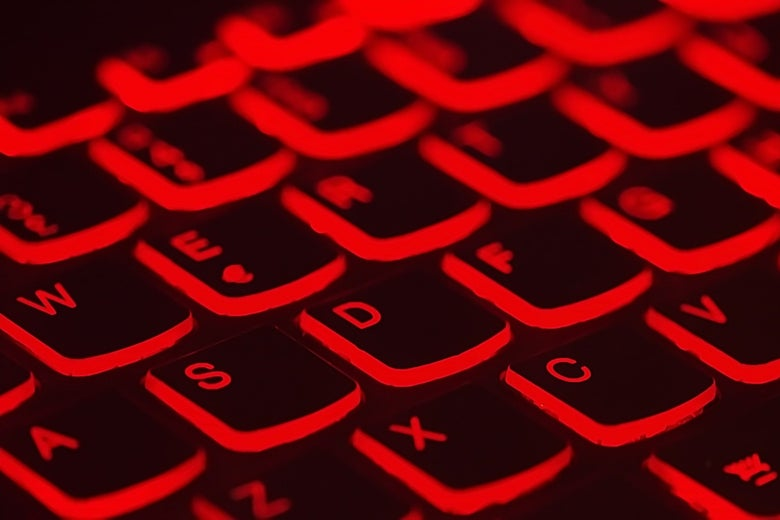 A computer keyboard backlit in red