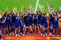 Japan's Womens soccer team celebrate their win.