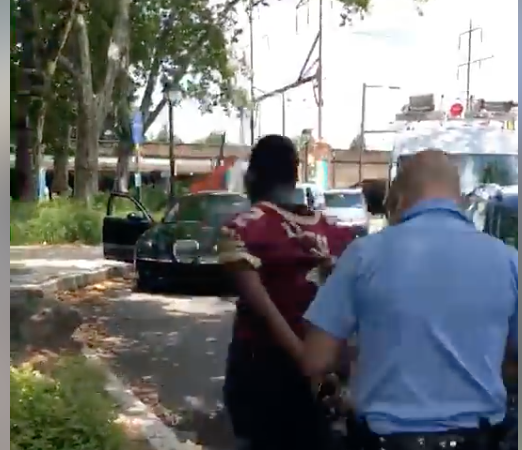 A screenshot of the video that is going viral on social media shows a police officer arresting a 14-year-old outside the Philadelphia Zoo on July 5, 2018.