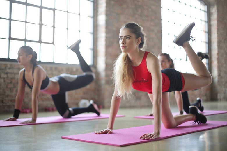A group of women doing yoga.