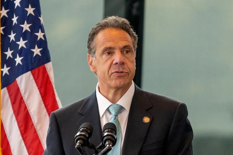Andrew Cuomo speaking at a podium at One World Trade Center
